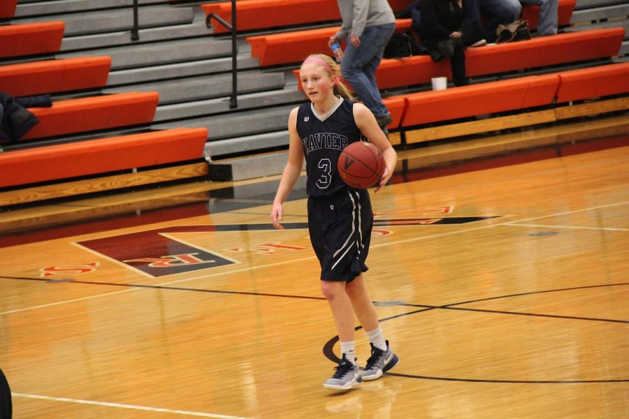 Freshman Caitlynn Daniels  dribbles the ball in a game against West Des Moines Valley. Becky Stovie Photo.