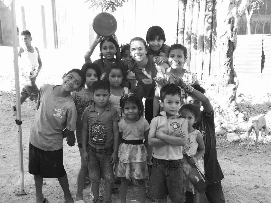 Junior Janessa Klein poses with the children of Nicaragua.  Klein Photo.