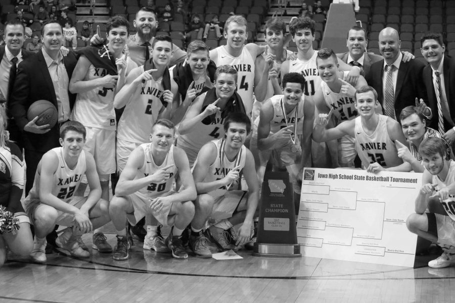 Above: The boys' basketball team poses for a photo following their championship win over Sergeant Bluff-Luton. Emiko Coffey Photo.