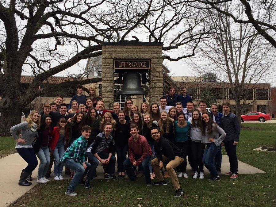 Students pose in front of the Luther Bell after performing in the Dorian Invitational Choral Festival at Luther College. Mr. Matt Walker Photo.