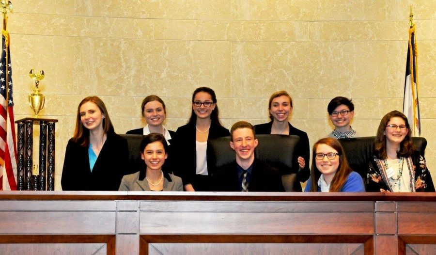 Top left: Junior Sophie Cataldo presents her opening statement. Top right: Junior Emily Cunningham testifies.              Bottom: Team Sunday poses with their trophy. Photos courtesy of the Iowa State Bar Association.