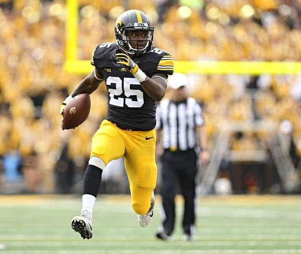 Akrum Wadley breaks a run against Wyoming with his signature high step move Stephen Mally/The Gazette Photo.