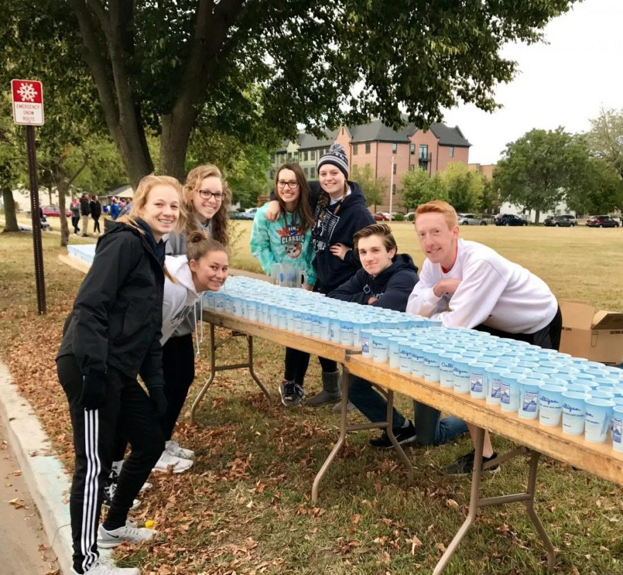 Xavier Key Club members help out at the Especially For You Race. Xavier Key Club Photo.