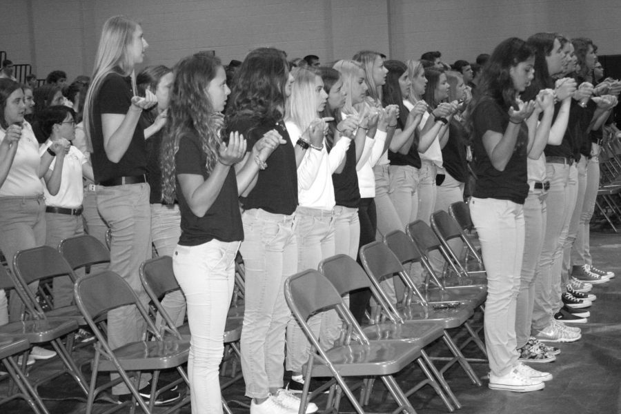 """Xavier Students join hands to say the """"Our Father"""" during mass. Mrs. Kellie Wagner Photo."""