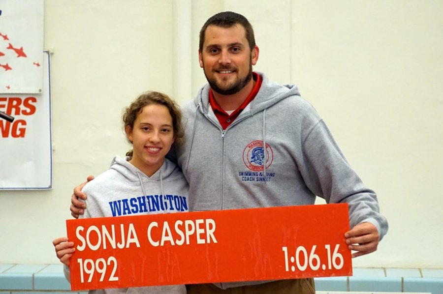 Washington co-op swimmer senior Lauren Havertape poses with her coach and the Washington High School 100 breaststroke record she broke in the regional meet. Brian Hughes Photo.