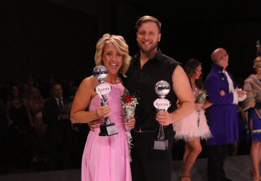 Jodi Schimberg and Brody White pose with their trophies for the People's Choice Award. Emiko Coffey.