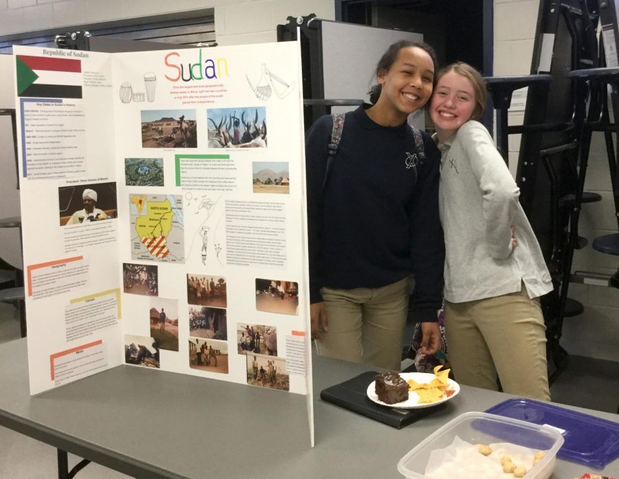 Sophomores Bryana Yanga and Ella Kane present information about foreign countries during the Cultural Fair in the Xavier commons. Vicki Hoffman Photo.