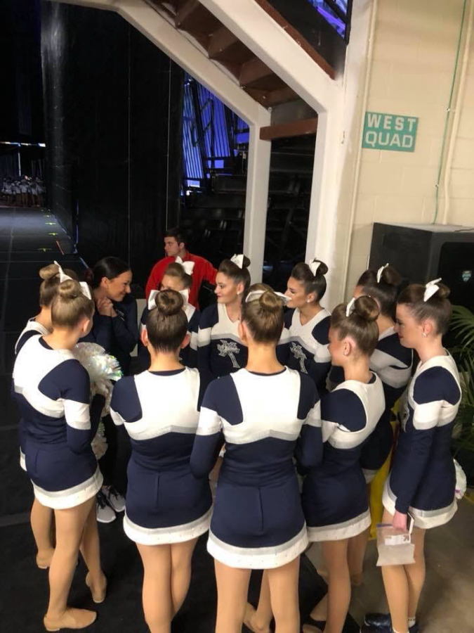 Xavier Dance Team and coach Jess Novotny gather together before they perform at the National Dance Team Championship in Orlando, Florida. Photo Submitted.