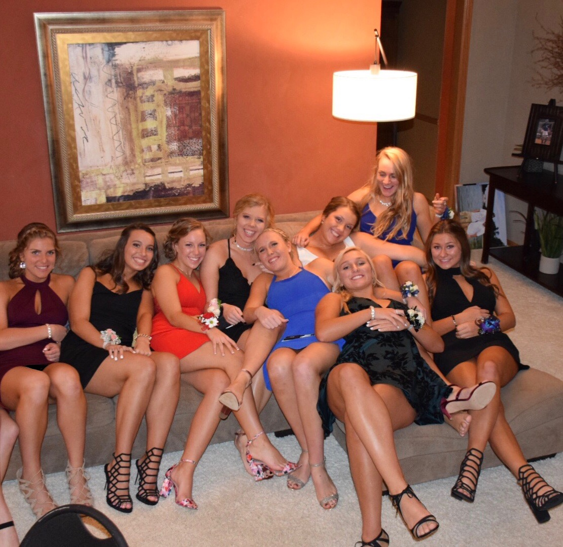 Claire Delaney and friends pose before homecoming. Linn Willey Photo.