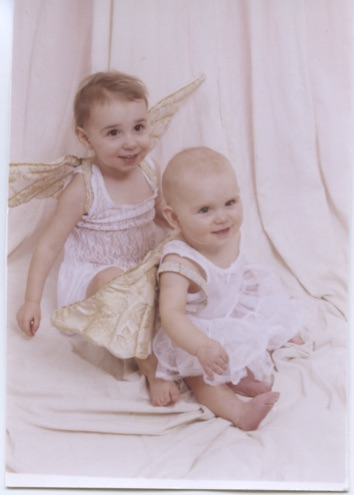 Katie Tallett (X17)(left) and Mary Tallett (right) pose as angels for a photoshoot as toddlers. Anne Tallett Photo.