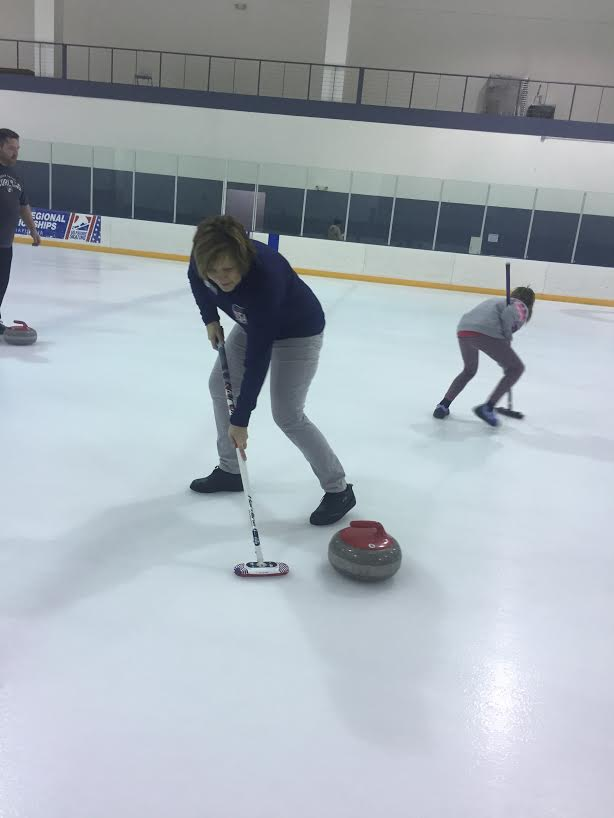 Xavier receptionist Lynn Benkusky-Karpick practices curling at the Cedar Rapids Ice Arena. Photo Submitted.