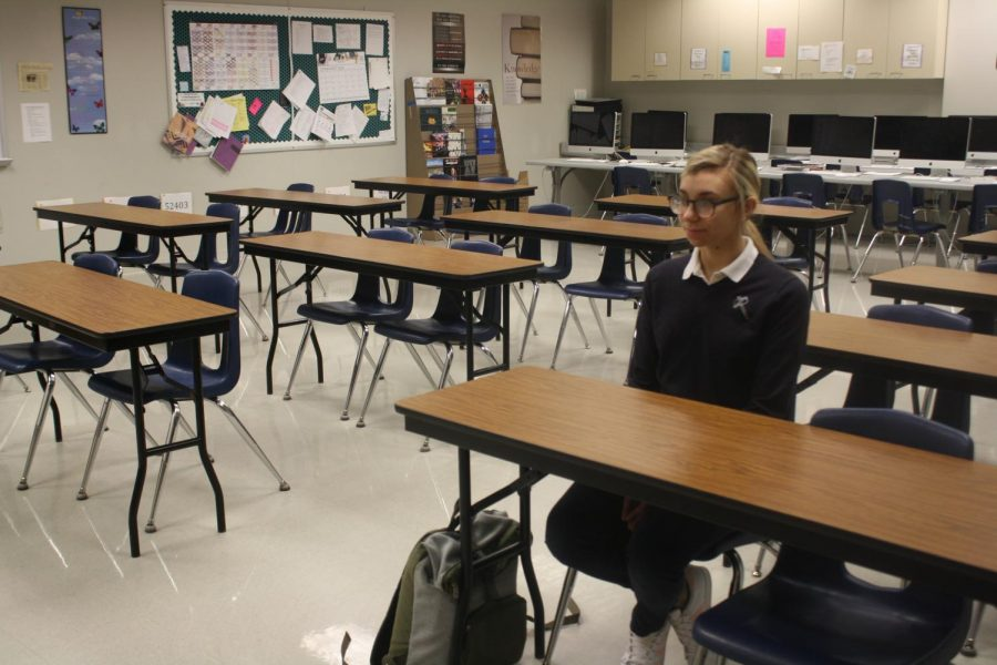 Senior Sylvia Clubb sits alone to represent her stance on walkouts. Kellie Wagner Photo.