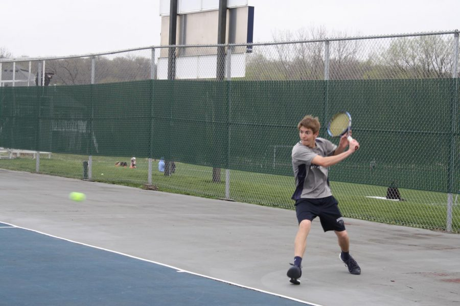 Senior Jon Lansing competes in a meet at the Xavier tennis courts during the 2017 season. Caroline Richardson Photo.