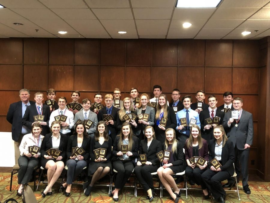 BPA students pose with their awards from the state conference in Des Moines. Bill Devereaux Photo.