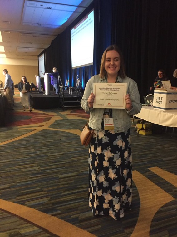 """McPherson recieves her """"Excellent in Sports Feature Photography"""" award at the National High School Journalism Conference in San Francisco California. Mrs. Kellie Wagner Photo."""