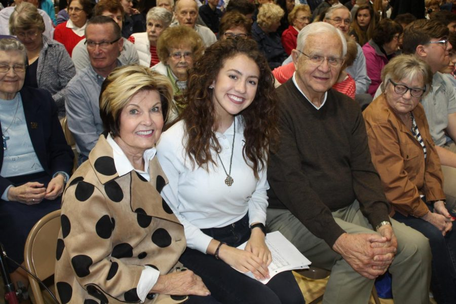Xavier students pose with their grandparents before Mass. Mr. Nick Ireland Photos.