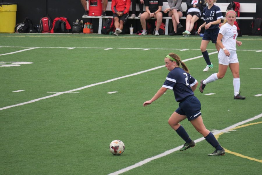 Senior Janessa Klein winds up to kick a ball during a game against Iowa City High on Tuesday, April 24. Photo Submitted.
