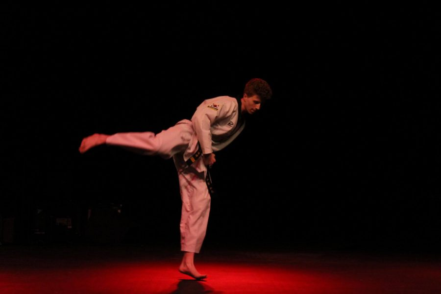 Senior+Jimmy+Burke+performs+a+Tae+Kwon+Do+demonstration.