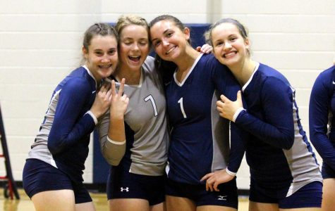 Sophomores Kya Loffswold, Grace Zaugg, Kate Burns, and Britt Bowersox pose for a photo after their home game.