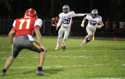 Ben Conrad (#28) kicks the ball during a game against Marion. The Saints went on to win 51-0.