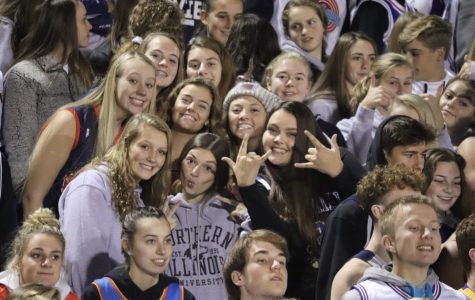 A group of juniors celebrate during a home football game game against Pella.