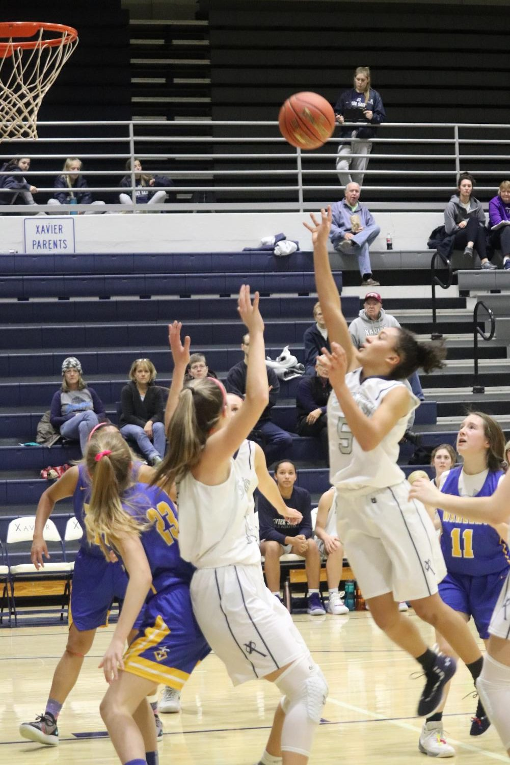 Junior Aubrey Jones (5) shoots the ball during a home game against Dubuque Wahlert.